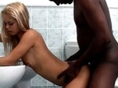 White in force age teenager blond cutie is having interracial sex with black dude in a washroom