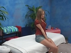 Pretty amateur cutie takes off her red top, blue jean petticoat and her tiny raunchy underware and then lies on massage table. Gracious and sexy masseur gives her fine massage and then screws the honey so hard.